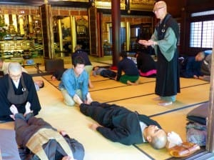 from Japan Times: Buddhist priest Issho Fujita instructs participants in a Zen meditation workshop| KYODO